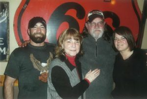 Paige Davidson (far right) with her brother Wade (far left), mother Trudy (middle left) and father Marty (middle right)